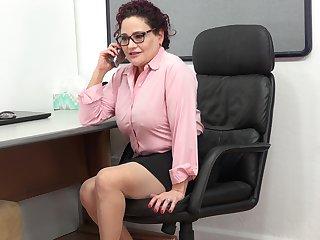 Vulgar mature woman is masturbating pussy in the office